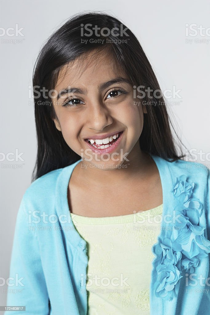 Pretty Middle Eastern elementary school age girl; studio shot royalty-free stock photo