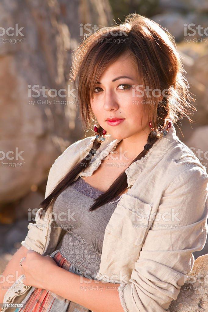 Pretty Native American Girl in Desert stock photo