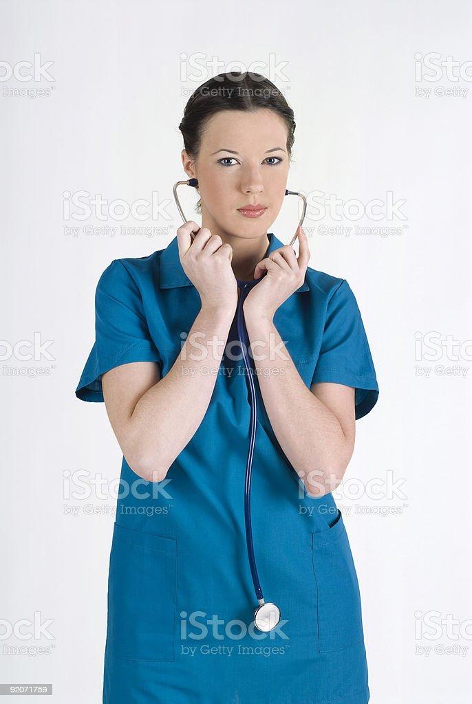 Pretty nurse using stethoscope royalty-free stock photo