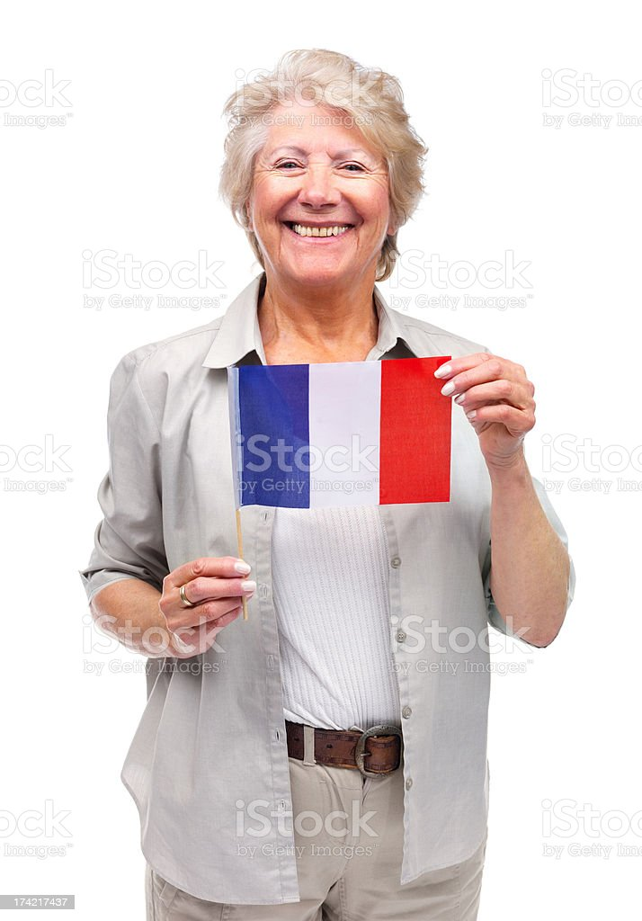 Pretty old female holding a flag of France royalty-free stock photo