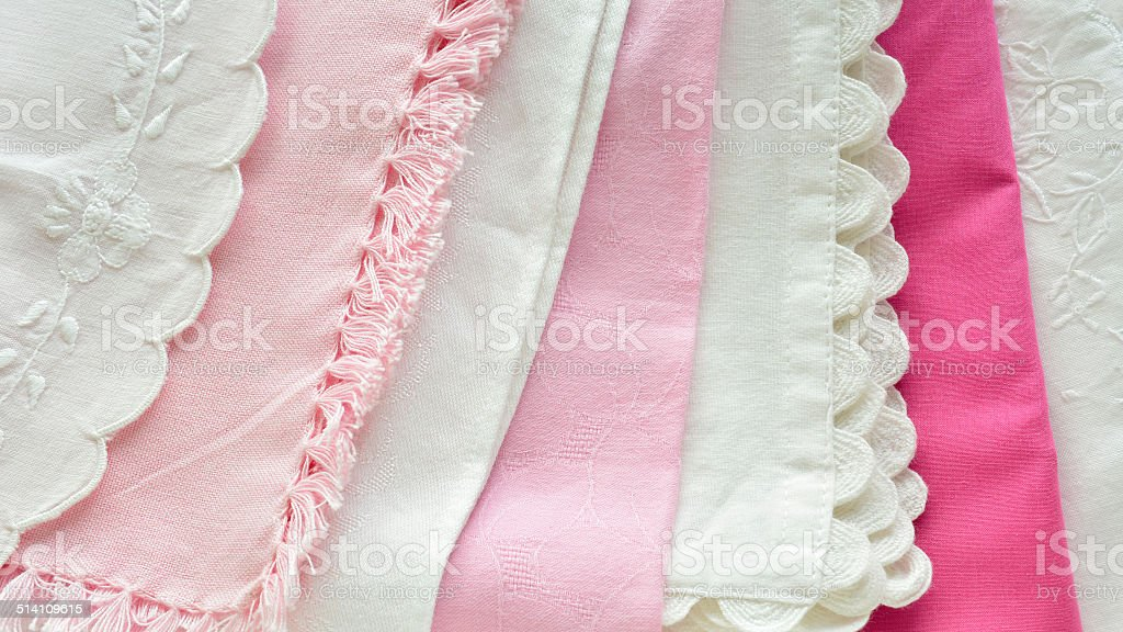 Pretty pink and white table linens stock photo