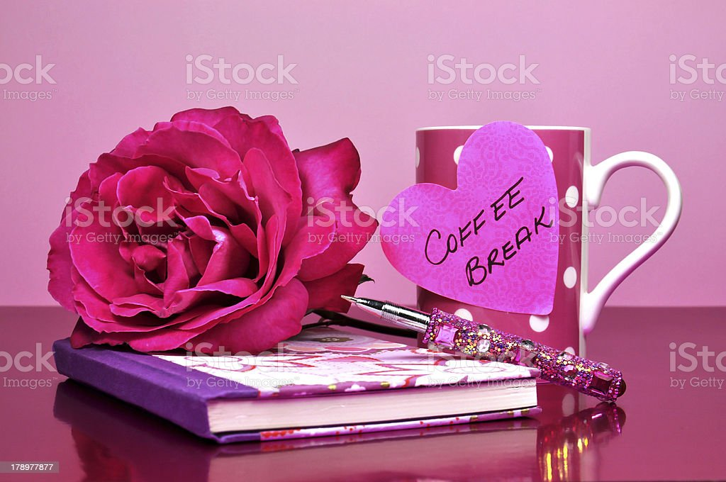 Pretty pink bling office accessories and iconic female symbols. royalty-free stock photo