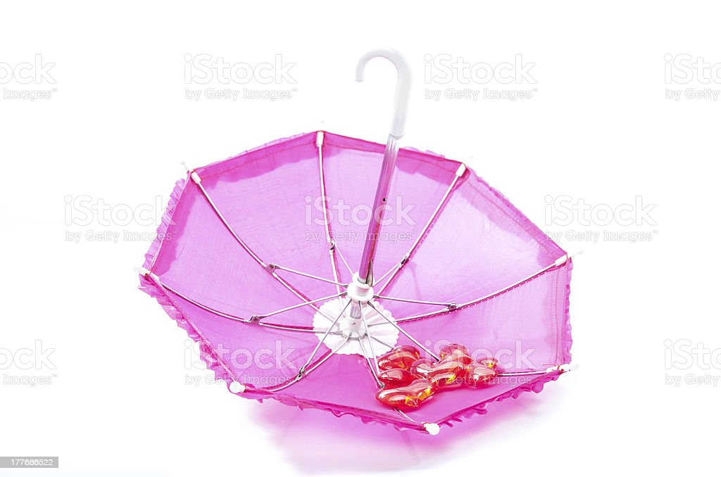 Pretty pink parasol with romantic hearts royalty-free stock photo
