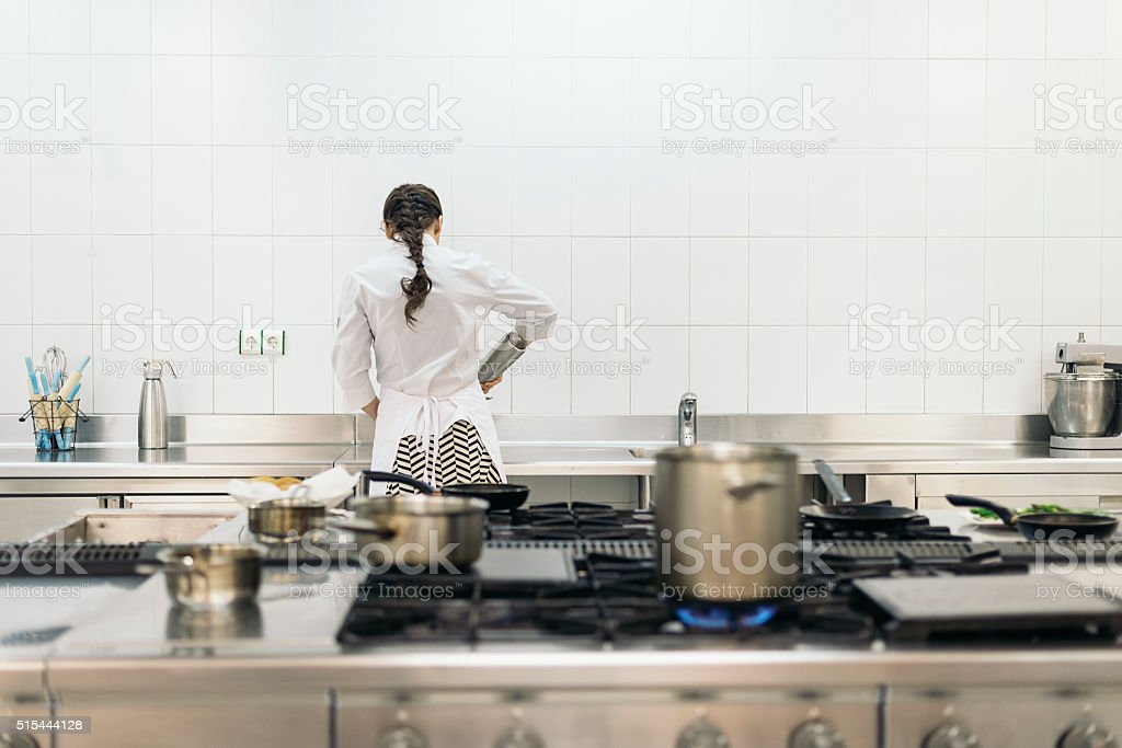 Pretty professional chef cooking. stock photo