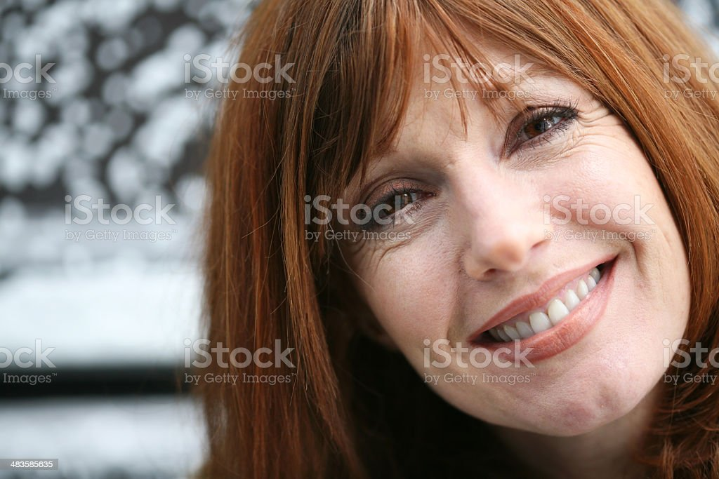 Pretty Redheaded Woman Smiling royalty-free stock photo