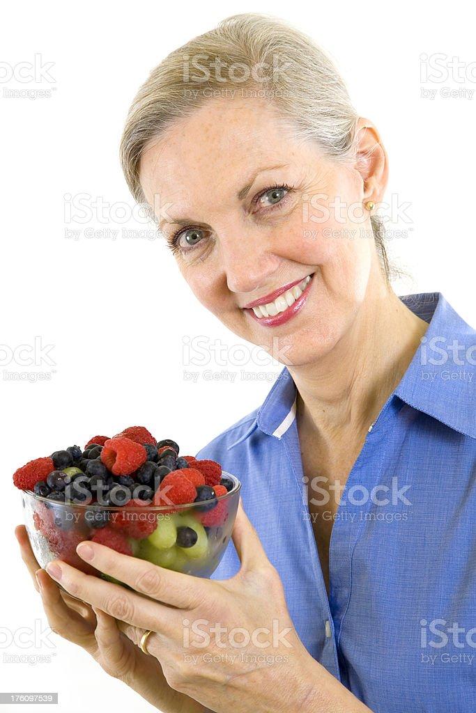 Pretty Senior Adult Female Holding a Bowl of Fresh Fruit royalty-free stock photo