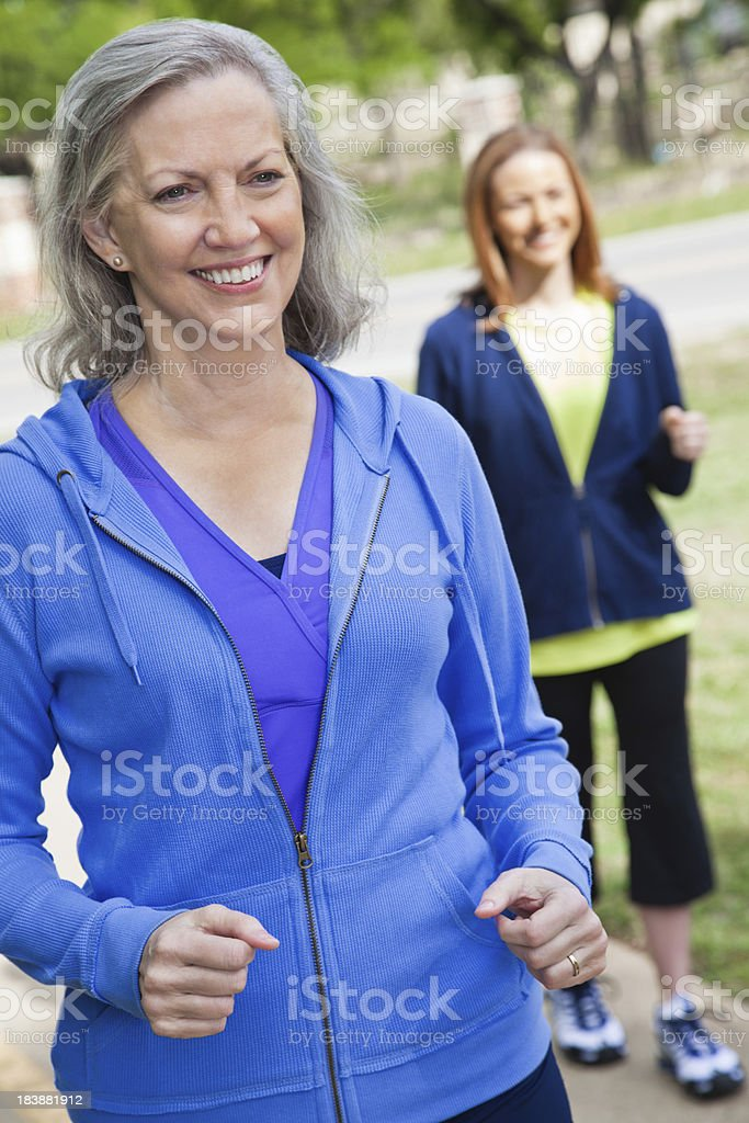 Pretty Senior Adult Woman Walking at a Park royalty-free stock photo