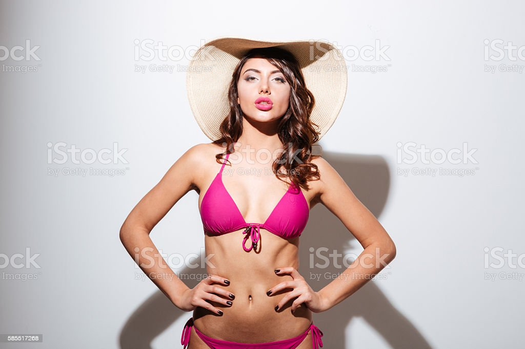 Pretty sexy attractive girl wearing beach hat and posing stock photo