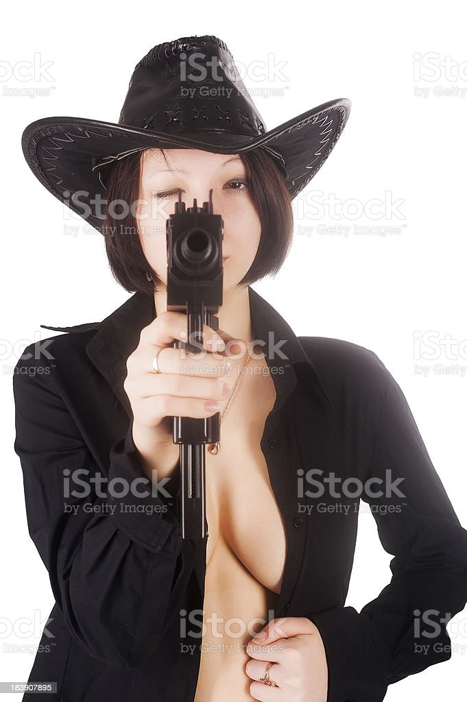 Pretty sexy girl aiming to you stock photo
