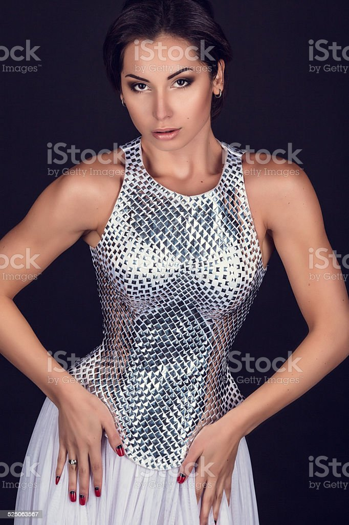 Pretty sexy girl full length posing in a fashion dress stock photo