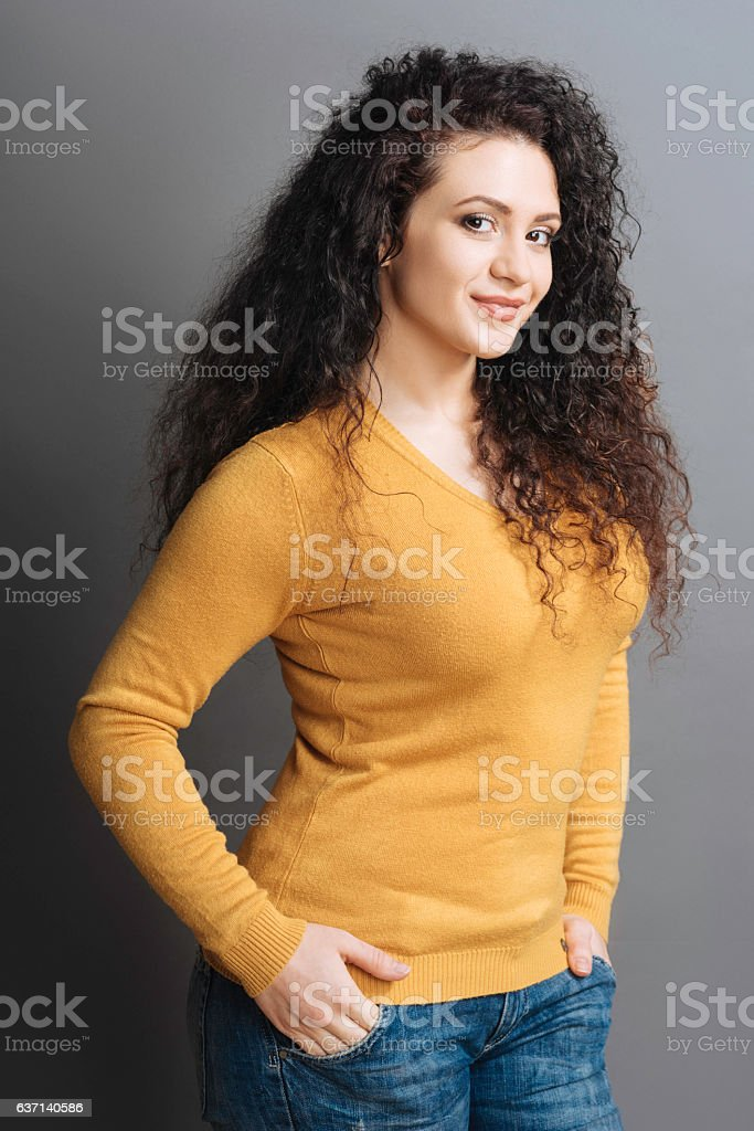 Pretty smiling girl standing in semi position stock photo