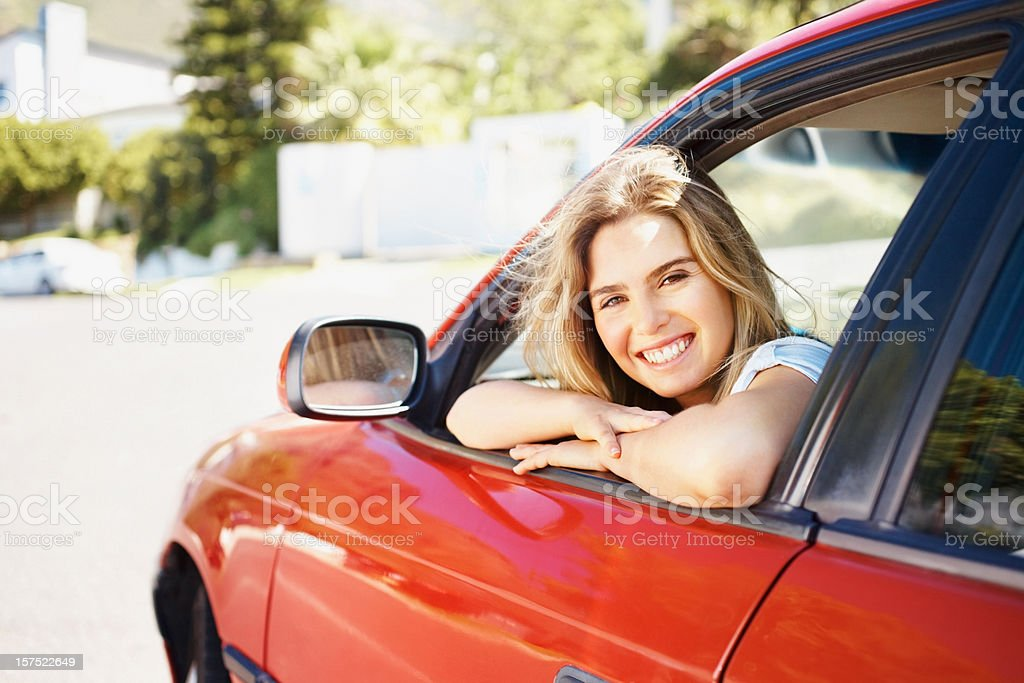 Pretty smiling teenage girl sitting inside the car royalty-free stock photo