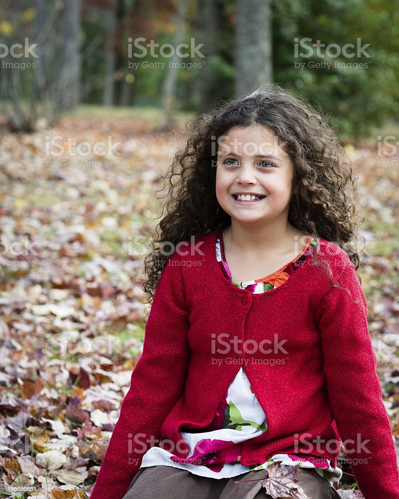 Pretty Smiling Young Girl Playing in the Park royalty-free stock photo