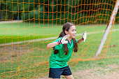 Pretty soccer goalie defends goal