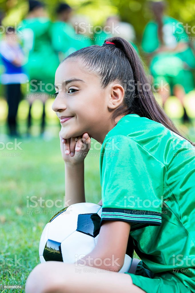 Pretty soccer player smiles before game stock photo