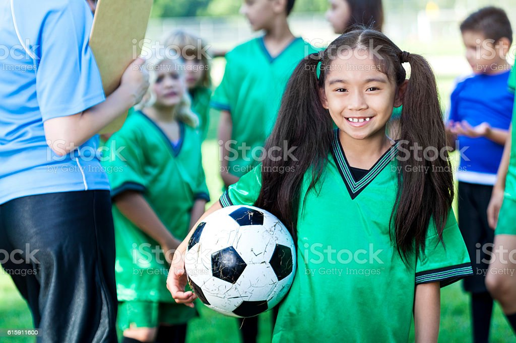 Pretty soccer player with her team stock photo