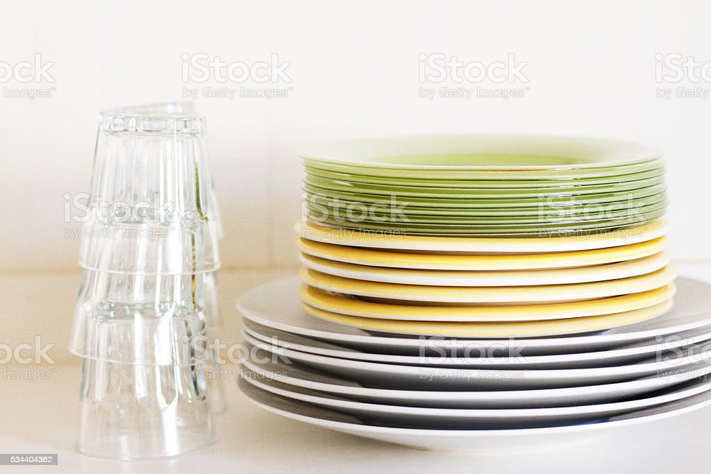Pretty Stacks of Plates and Tumblers (Close-Up) stock photo
