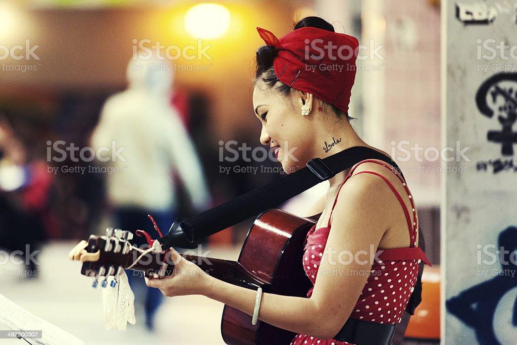 Pretty Street Performer stock photo