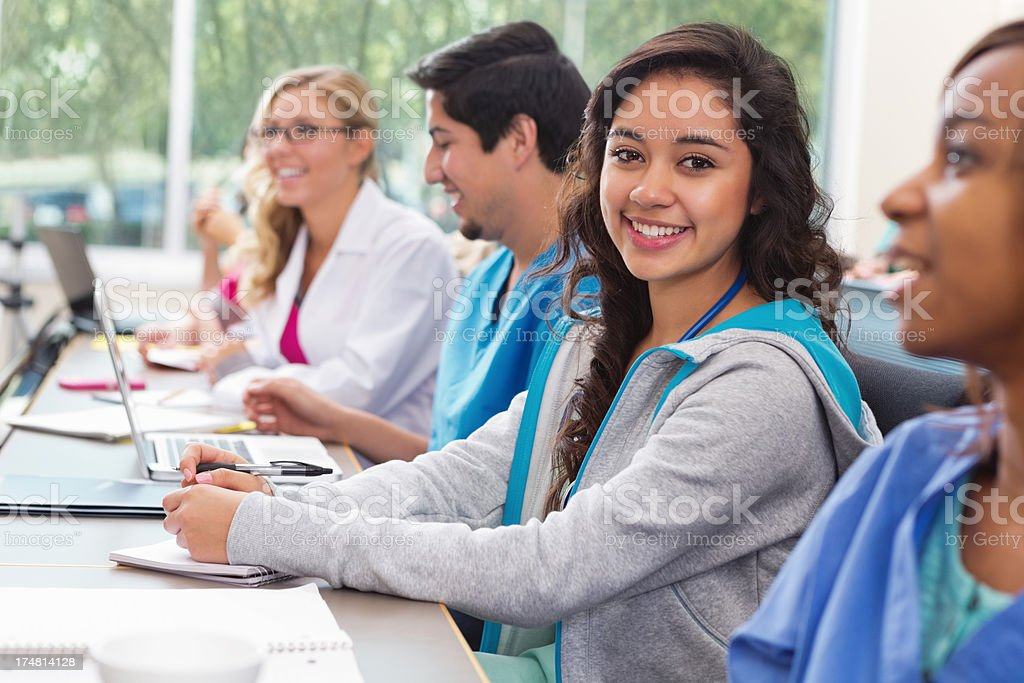 Pretty student smiling in nursing or medical school college class royalty-free stock photo