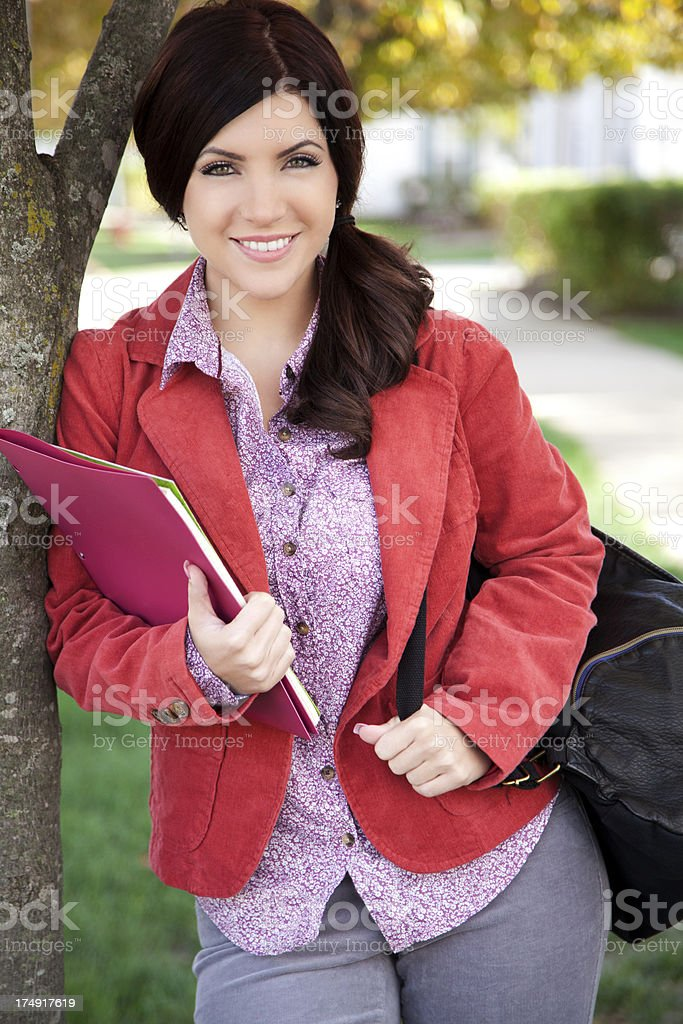 Pretty student smiling royalty-free stock photo