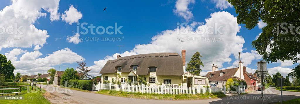 Pretty summer cottage village green royalty-free stock photo