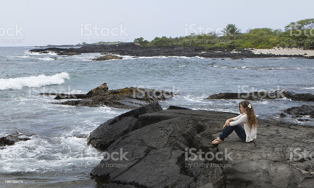 Pretty Teen Girl Meditating at Seashore stock photo
