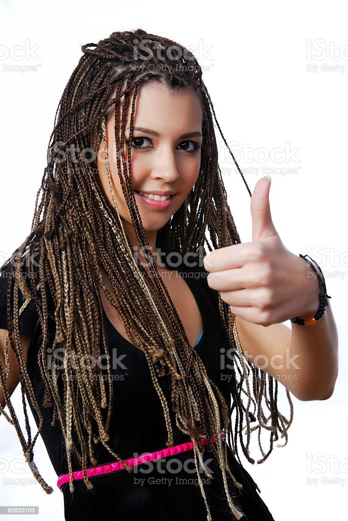Pretty teen girl showing the thumbs-up sign royalty-free stock photo