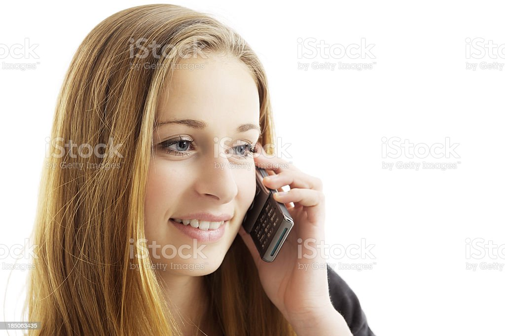 Pretty teen girl talking on mobile phone royalty-free stock photo