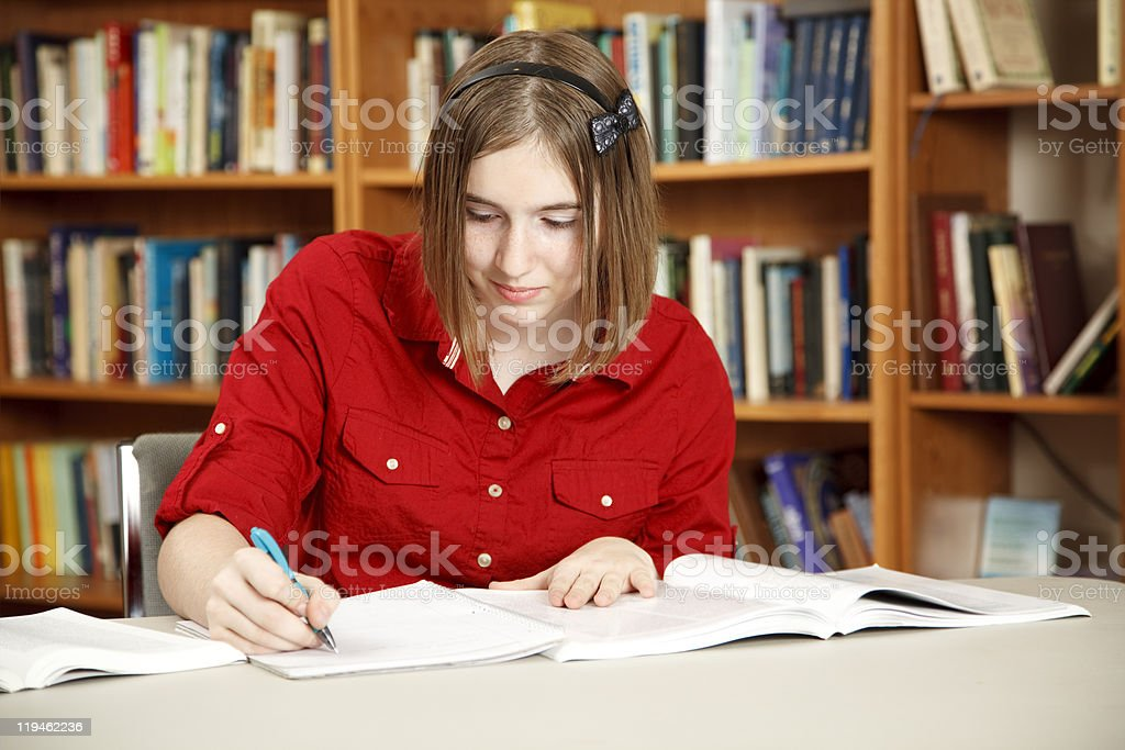 Pretty Teen In Library royalty-free stock photo