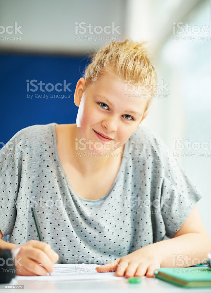 Pretty teenage female working at school. royalty-free stock photo