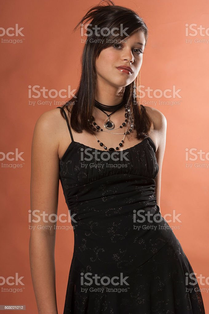 Pretty Teenage Girl in a Black Party Dress stock photo