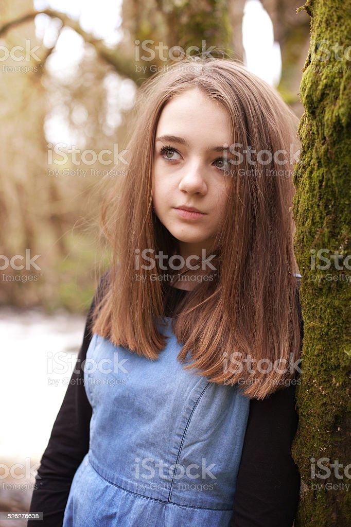 Pretty teenage girl looking upwards stock photo