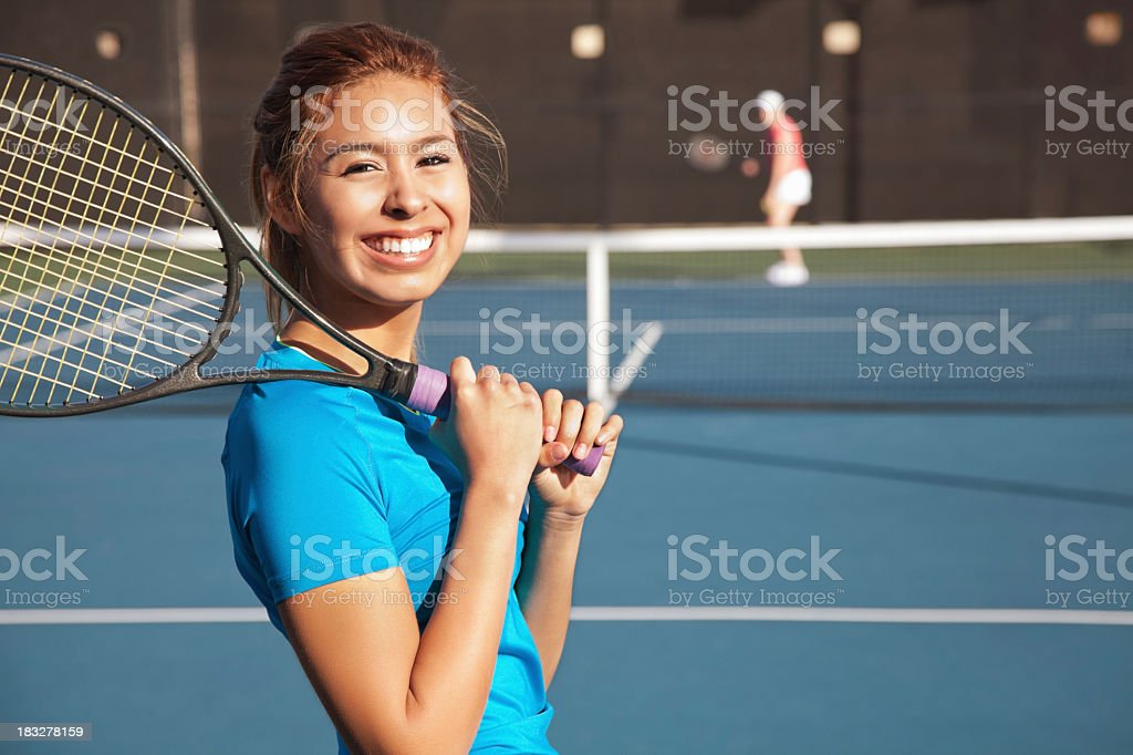 Pretty Teenage Tennis Player Playing a Match stock photo
