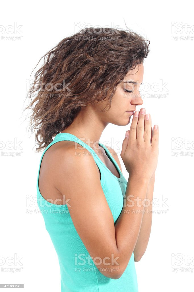 Pretty teenager girl praying royalty-free stock photo