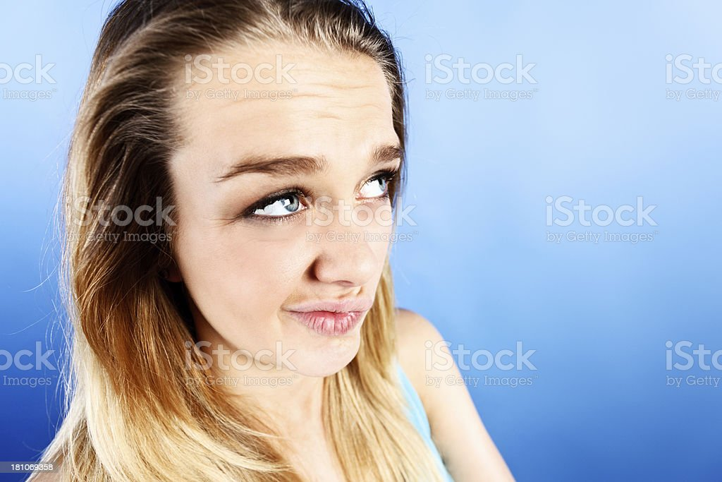 Pretty teenager sneers in cynical disbelief; can't fool her! royalty-free stock photo