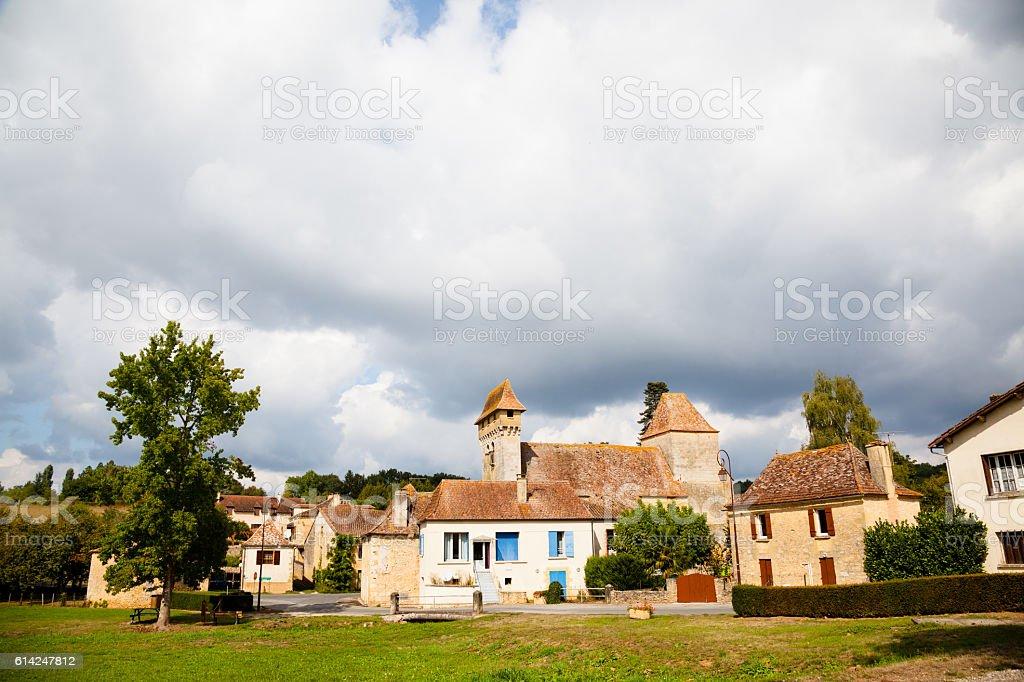 pretty traditional stone  French village and church Pressingnac Dordogne stock photo