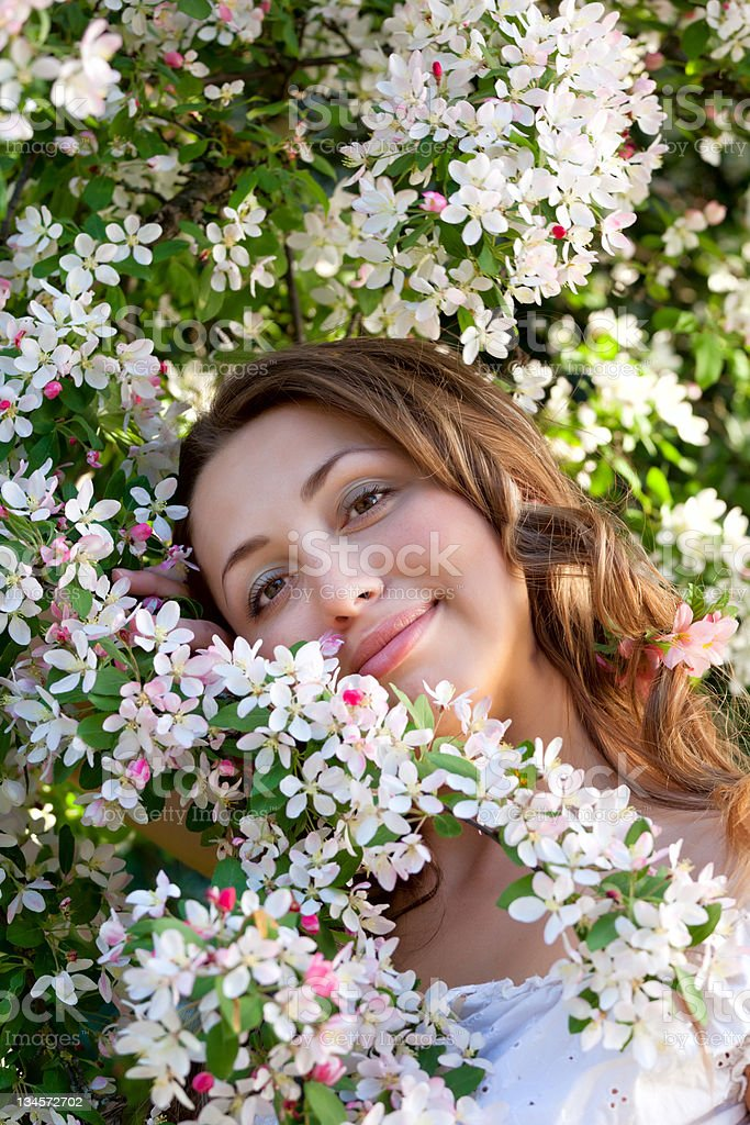 Pretty woman among a spring blossom royalty-free stock photo