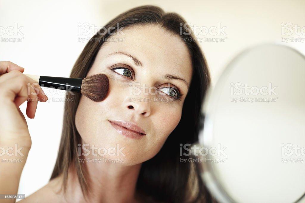 Pretty woman applying stock photo