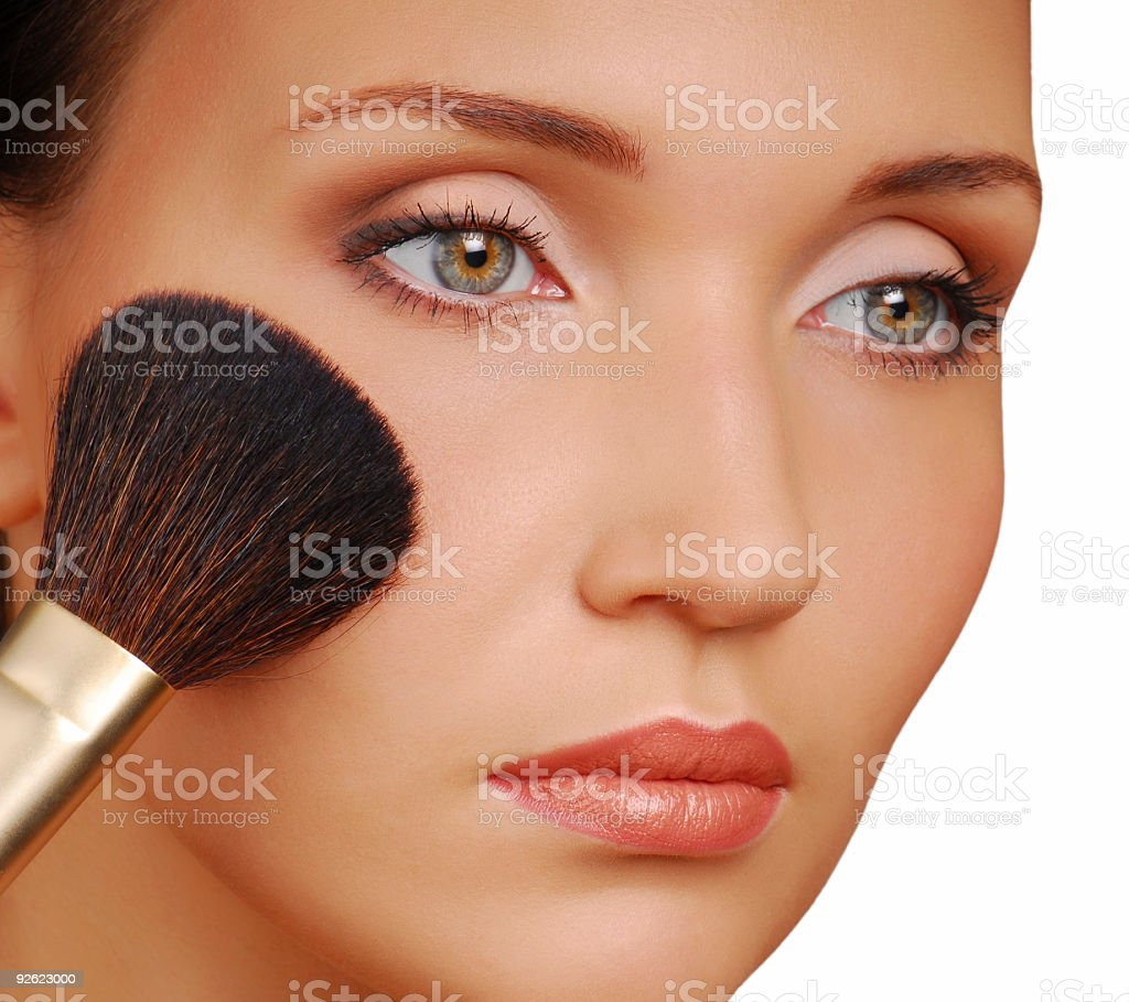 Pretty woman applying rouge royalty-free stock photo