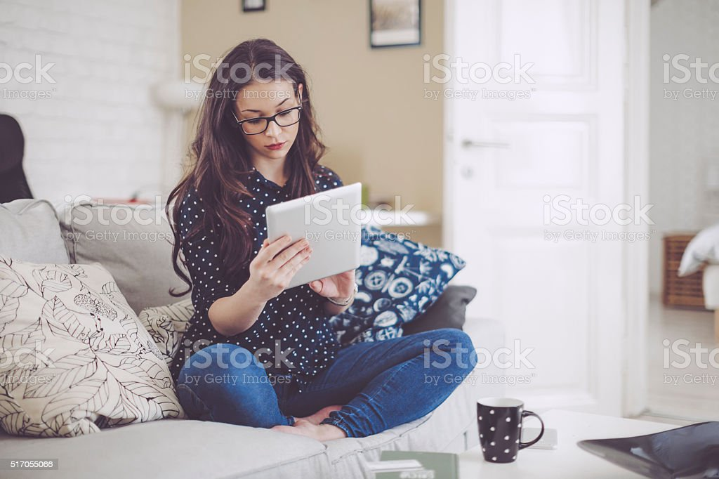 Pretty woman at home stock photo