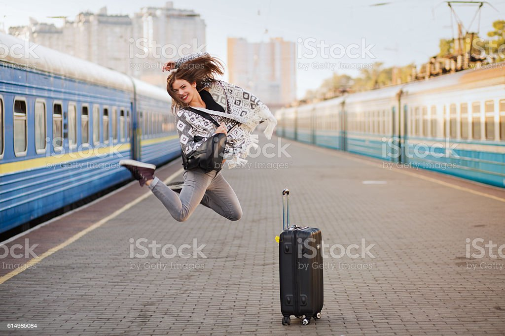 Pretty woman at the train station stock photo