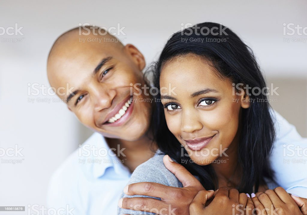Pretty woman being embraced by her boyfriend stock photo