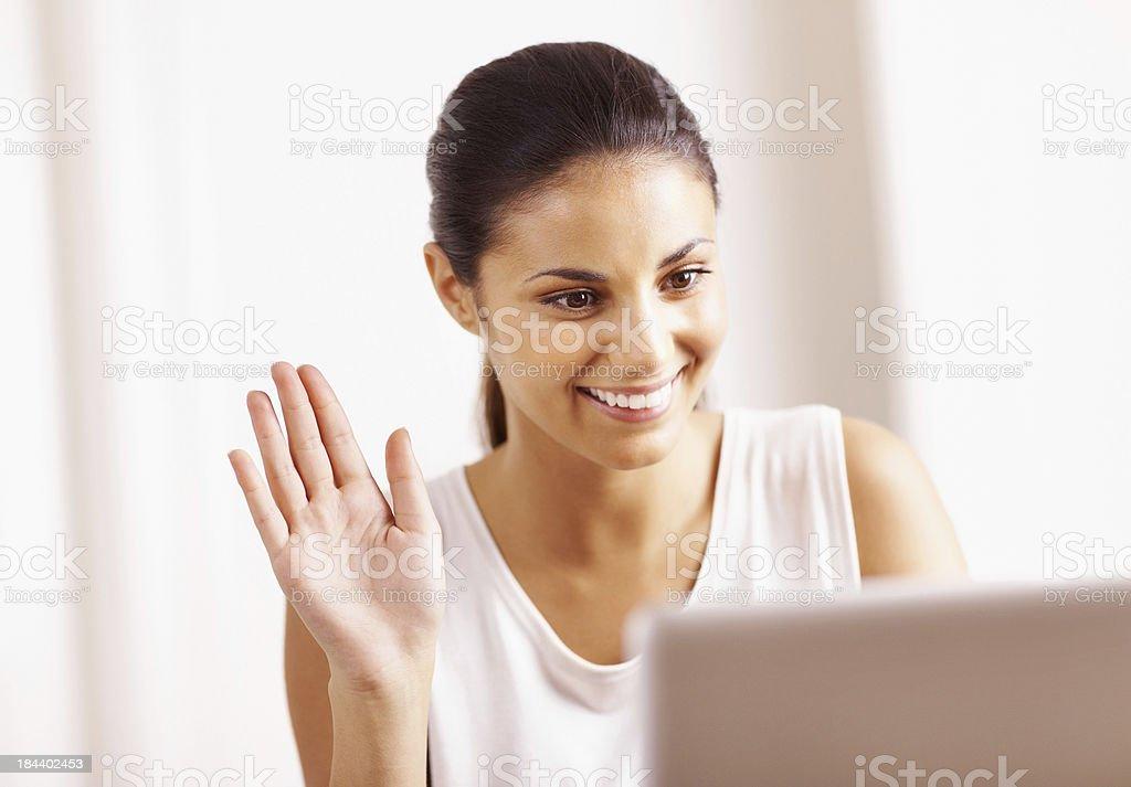 Pretty woman chatting online stock photo