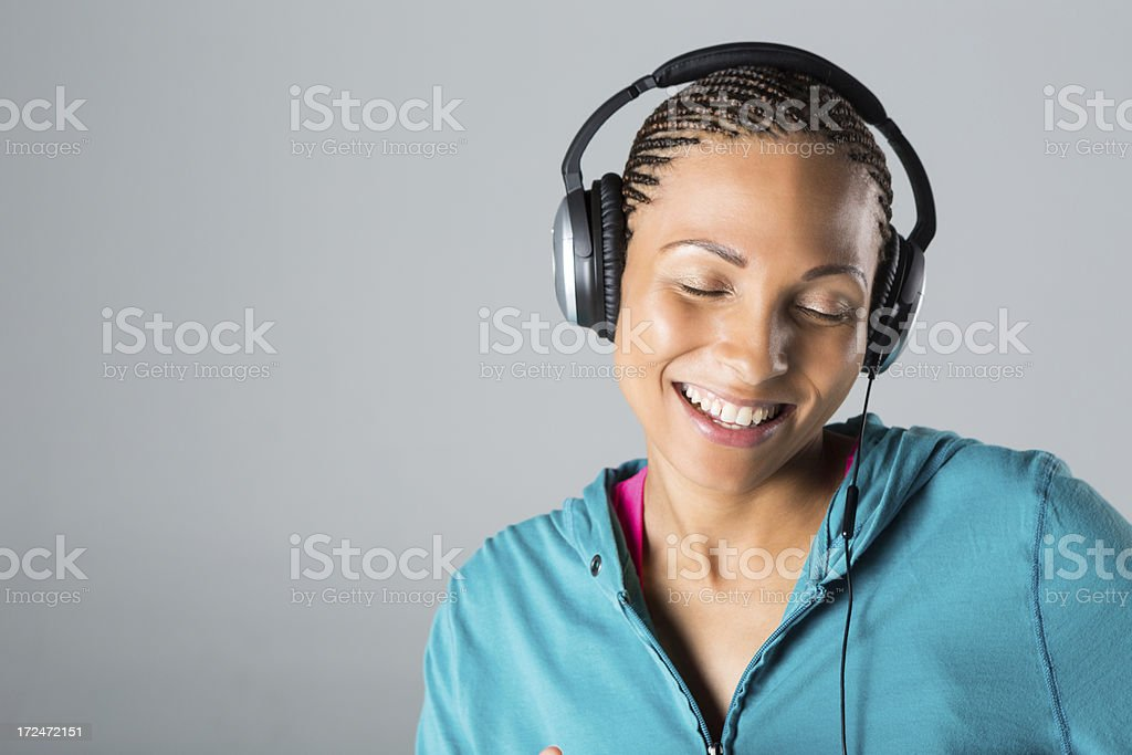 Pretty woman dancing with music through headphones royalty-free stock photo