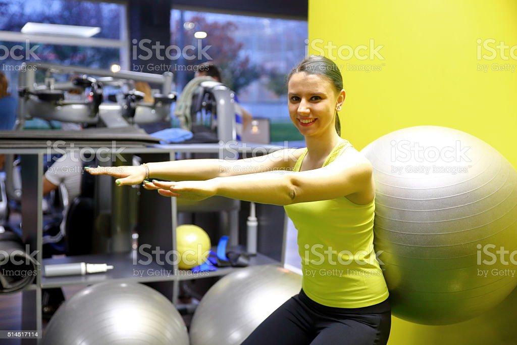 Pretty woman doing pilates stock photo