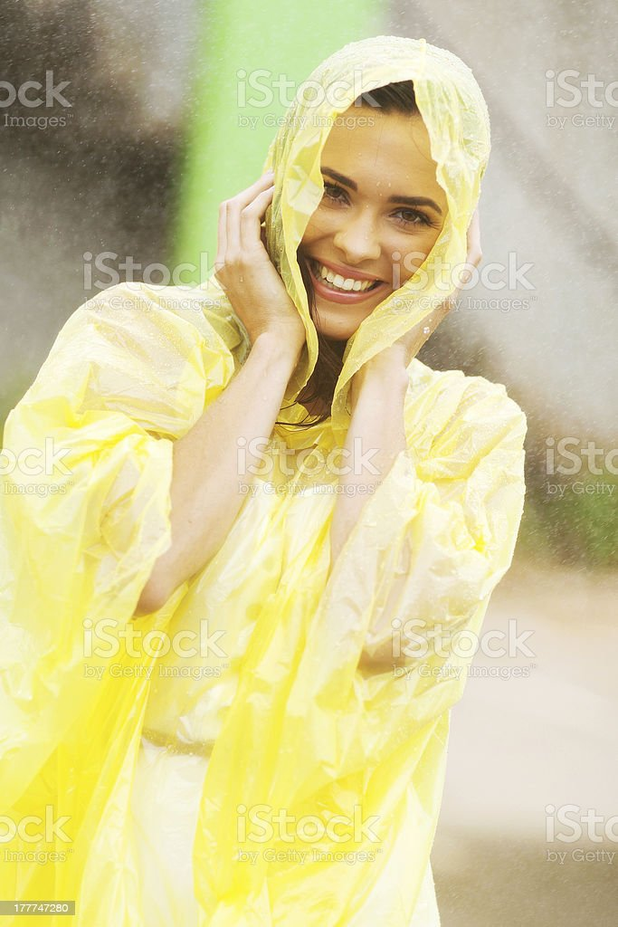 pretty woman dress in raincoat having fun stock photo