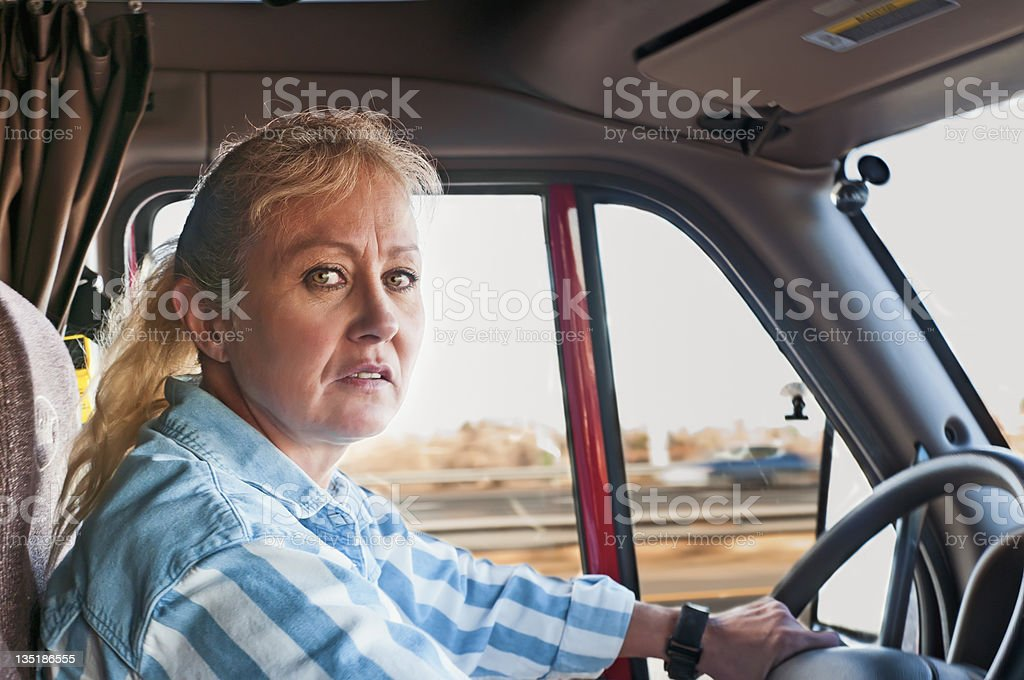 Pretty Woman Driving a Semi-Truck stock photo