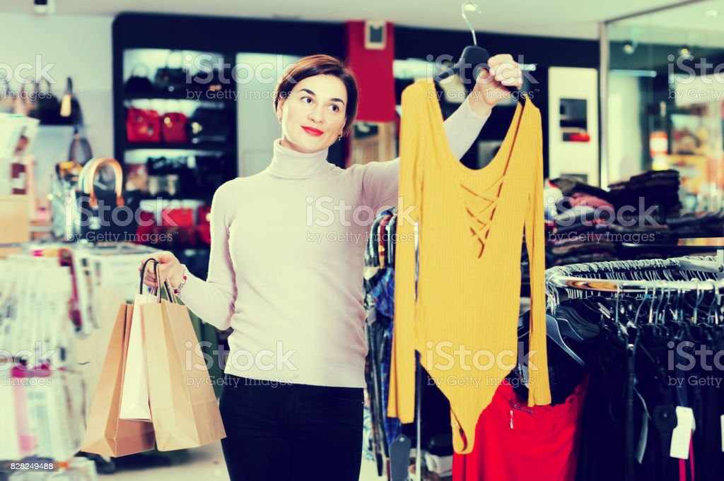 Pretty woman enjoying her purchases stock photo