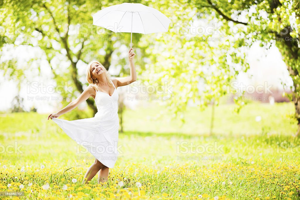 Pretty woman enjoying in the nature holding a white umbrella. royalty-free stock photo