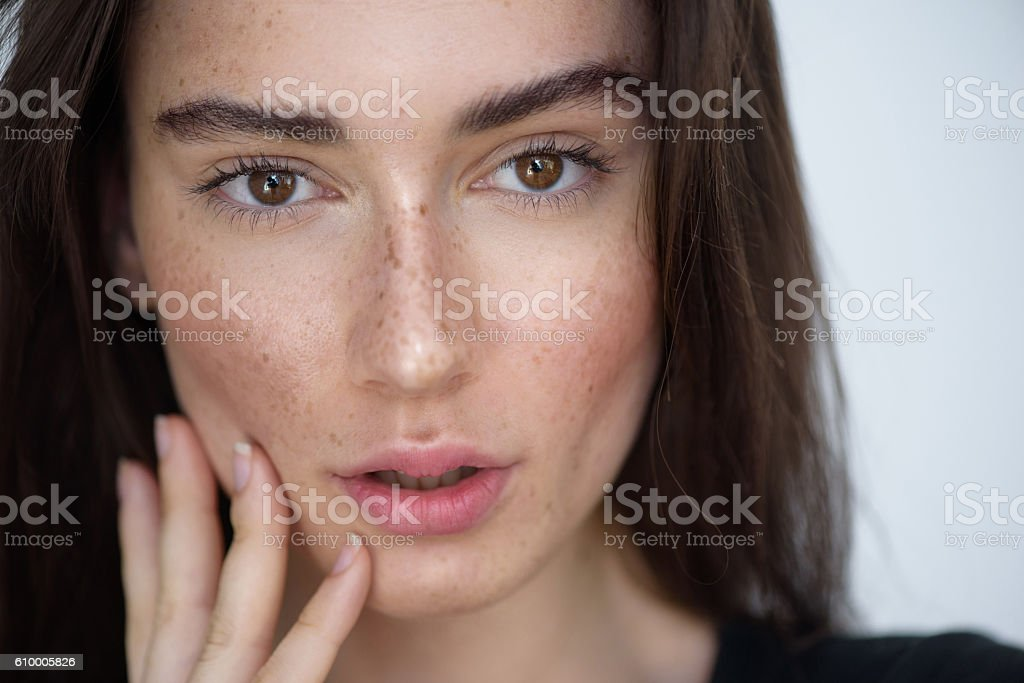 pretty woman face on light grey background stock photo